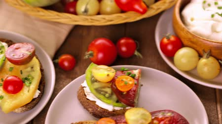 slice : Tomato sandwich made with organic heirloom tomatoes. Stock Footage