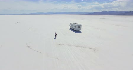 sierpien : Bonneville, Utah, USA-August 4, 2015. Driving motorhome on Bonneville Salt Flats, Utah.