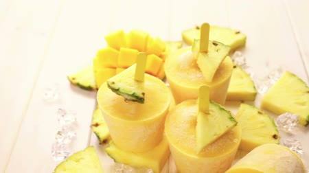 ananas comosus : Homemade low calorie pop ice made with mango, pineapple and coconut milk. Stock Footage