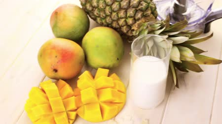 ananas comosus : Fresh ingredients on the table to make smoothie with tropical fruits.