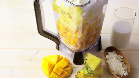 ananas comosus : Homemade mango and pineapple smoothie made with coconut milk.