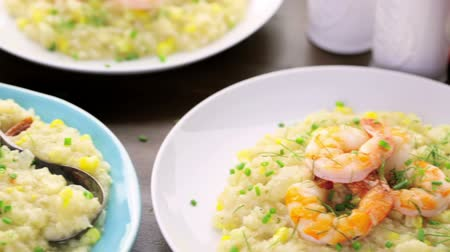 só : Homemade corn risotto with roasted shrimp on dining table.