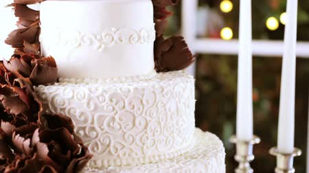 tiered : Gourmet tiered wedding cake at wedding reception.