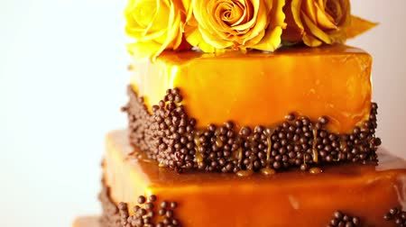 формальный : Gourmet tiered wedding cake as centerpiece at the wedding reception.