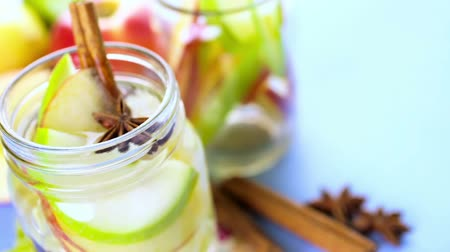 infused water : Infused apple water with cinnamon and anise. Stock Footage