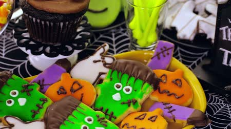 разница : Variety of sweets prepared as Halloween treats.