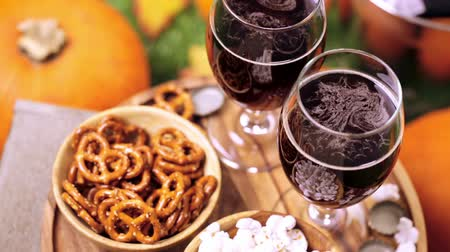 craft beer : Craft pumpkin beer in beer glasses with salty pretzels and popcorn.