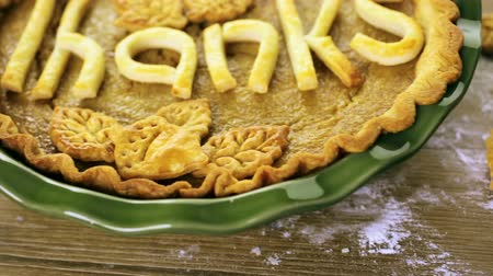 turta : Homemade pumpkin pies with Give Thanks sign and Autumn stamped leafs.