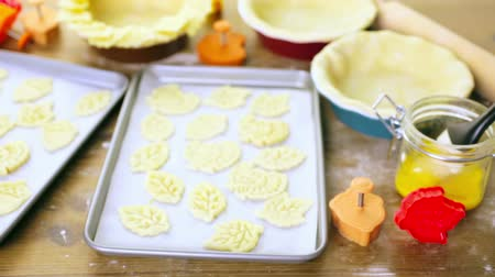 pastry stamper : Cutting out Autumn leafs with cookie stamper to decorate pumpkin pie.