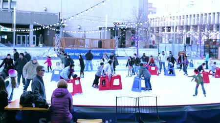 skate : Denver, Colorado-December 13, 2015: Outdoor ice skating rink at Skyline Park.