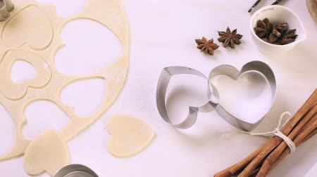 pişmiş : Baking heart shaped sugar cookies for Valentines Day. Stok Video