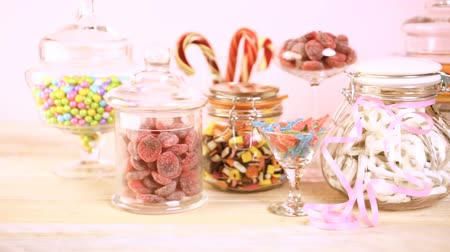 colorful candy : Multicolored candies in glass candy jars. Stock Footage