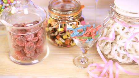 soft : Multicolored candies in glass candy jars. Stock Footage