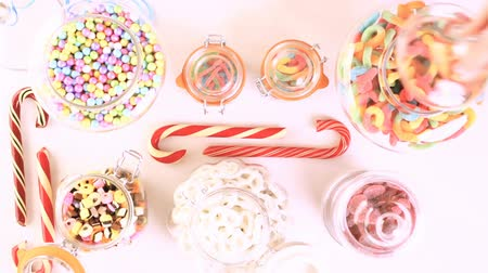 soft : Multicolored candies on a white table. Stock Footage