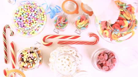 colorful candy : Multicolored candies on a white table. Stock Footage