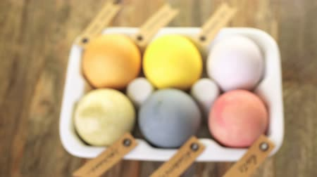 etiketler : Easter eggs painted with natural egg dye from fruits and vegetables. Stok Video