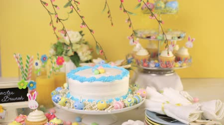 miniatűr : Dessert table set with cake and cupcakes for Easter brunch.