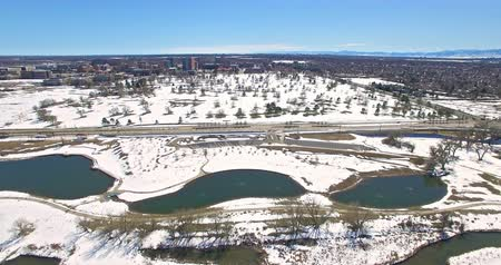 télen : Aerial view of natural park with ponds in the Winter. Stock mozgókép