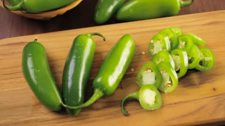 organic : Sliced ??organic Jalapeno Pepper on cutting board. Stock Footage