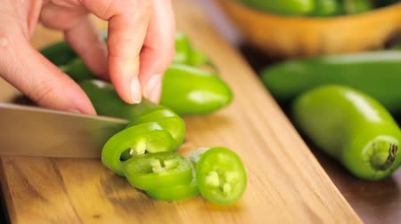 bitkisel : Sliced ??organic Jalapeno Pepper on cutting board. Stok Video