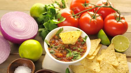 dips : Fresh salsa in white bowl with ingredients.
