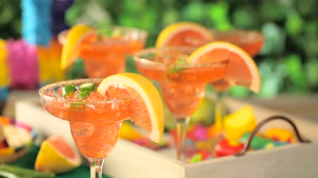 pimentas : Spicy grapefruit margarita on ice in margarita glasses. Stock Footage