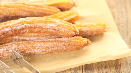 fried : Bunch of churros covered with granulated sugar.