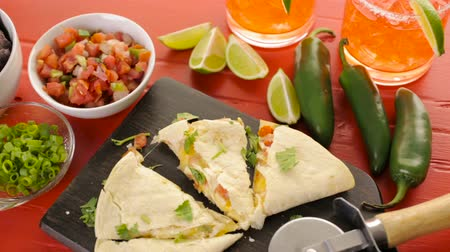 slice : Sliced ??quesadilla filled with cheese, chicken and pico de gallo.