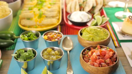 enrolado : Fiesta party buffet table with traditional Mexican food.