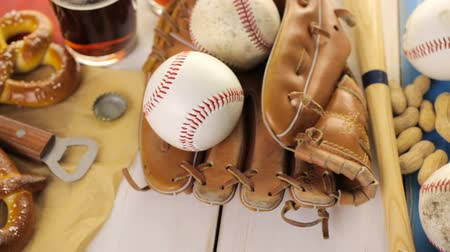 используемый : Close up of old worn baseball equipment on a wooden background.