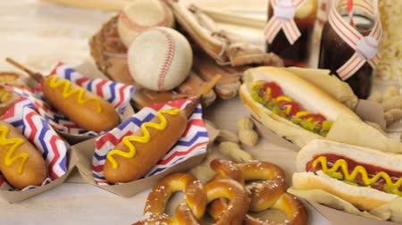 pretzel : Baseball party food with balls and glove on a wood table. Stock Footage