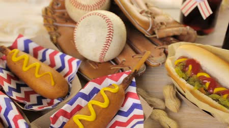 soft : Baseball party food with balls and glove on a wood table. Stock Footage