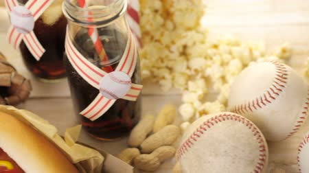 karbonatlı : Baseball party food with balls and glove on a wood table. Stok Video