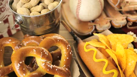 pretzel : Game day traditional snacks included corndogs and salted peanuts on a wood board.