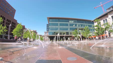 karpatské : Denver, Colorado, USA-May 30, 2016. Urban plaza with jet fountains at front of Union Station in Denver, Colorado.