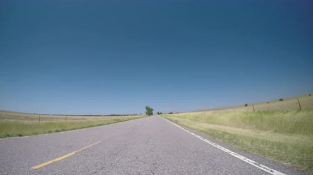 droga : Driving on country road surrounded by agricultural fields. POV point of view. Wideo