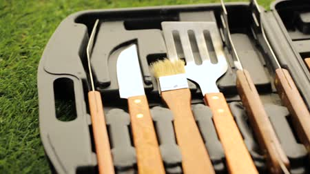 barbecue set : Stainless steel barbecue cooking set with wood handles.