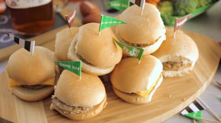 alkol : Sliders with veggie tray on the table for the football party. Stok Video