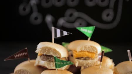 előételek : Sliders with veggie tray on the table for the football party. Stock mozgókép