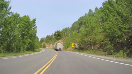 er : Denver, Colorado, USA-June 21, 2016. Motorhome driving through alpine forest on Mount Evans-POV point of view. Stock Footage