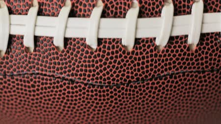 koronka : Close up of brown leather and white laces of American Football.