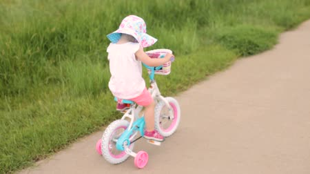 karpatské : Toddler learning how to ride her first bike.