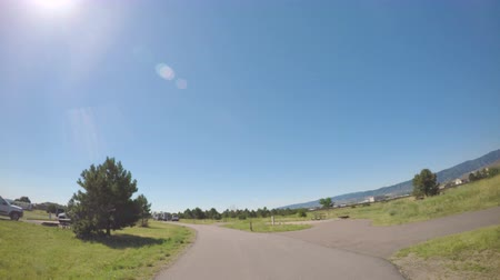 rv park : Denver, Colorado, USA-July 4, 2016. Car driving through campground with motorhomes at Chatfield State Park.-POV point of view.