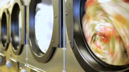 indústria : Industrial washing machines in a public self service laundry