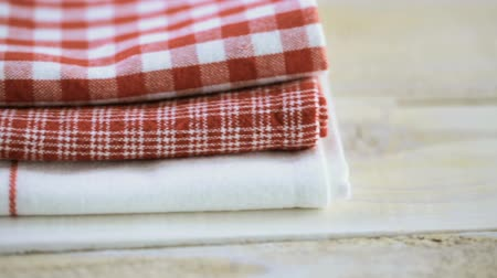 towel folded : Dish towel on a wood background.