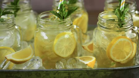 Beverage tray with with iced tea with citrus. Stock Footage