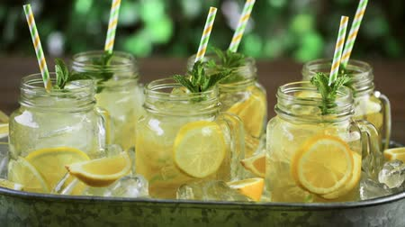Beverage tray with with iced tea with citrus. Stock mozgókép