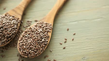 orzechy : Flax seeds on painted wood board.