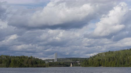 ködös : Wide view of a Canadian Lake - Bridge in the background Stock mozgókép