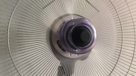 rész : Close up of desktop fan for continue until slow down of propeller rotation Stock mozgókép